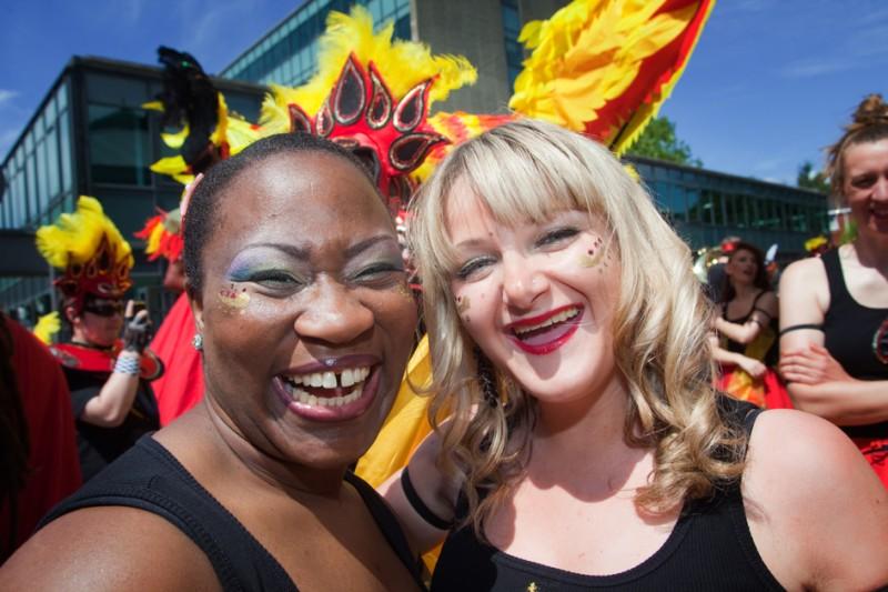 Samba School dancers smiling at manchester day parade