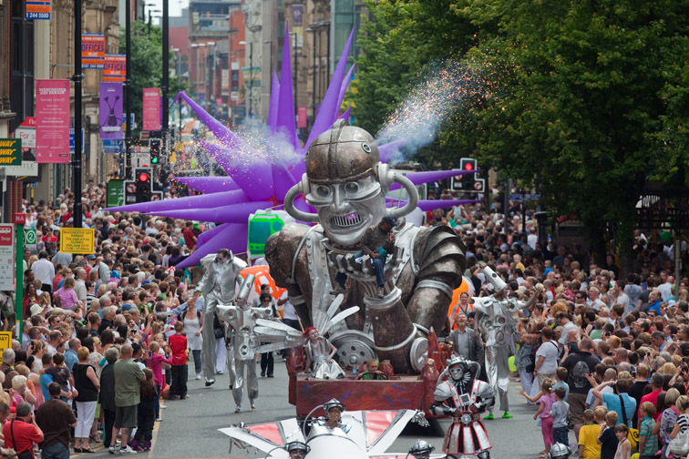 Manchester's first Manchester day parade makes it was down Deansgate.