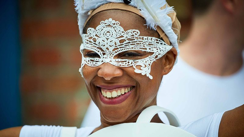 Manchester Day 2017 woman dancer smiling at camera in mask