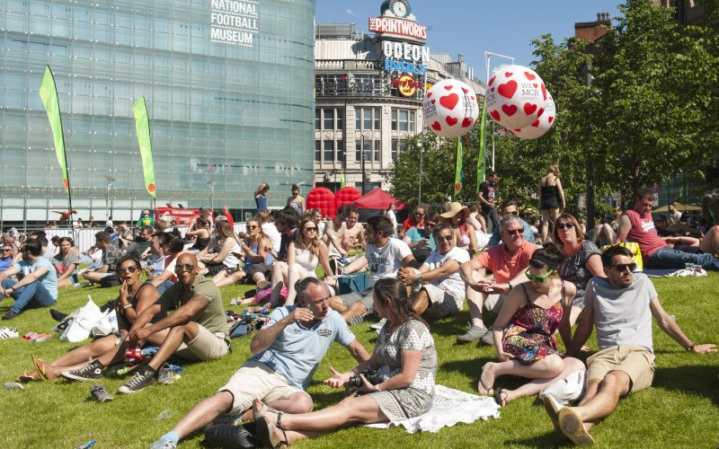 MANCHESTER DAY 2017 people sitting in the park