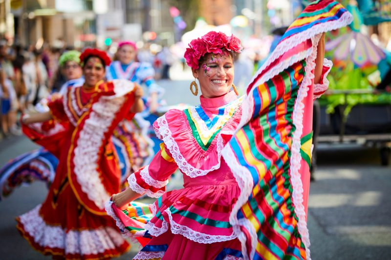 MANCHESTER DAY 2017 women dancin gin Spanish dresses in the parade